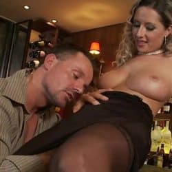 Slutty blonde in stockings fucks horny hunk in a bar
