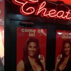 Busty babe gangbang in adult theater